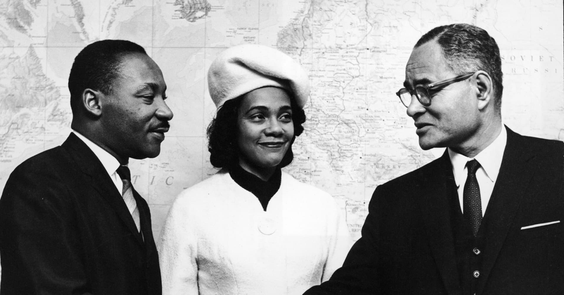 American civil rights leader Dr. Martin Luther King, Jr. and his wife Coretta are greeted by Ralph J. Bunche, United Nations Under-Secretary, at the United Nations, New York City, New York, Dec. 04, 1964.