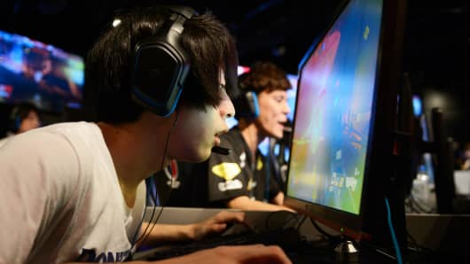 Attendees play Activision Blizzard Inc.'s Overwatch computer game at the AOC Open e-Sports event in Tokyo.