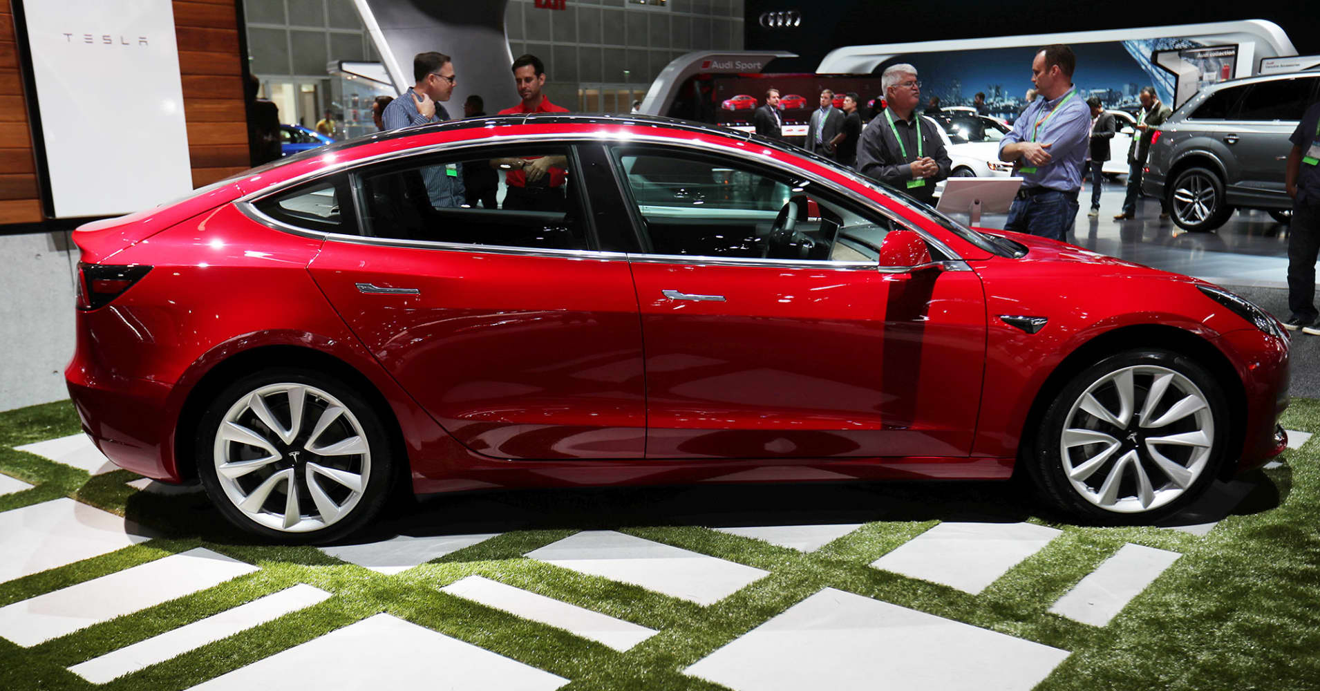 Early reviews heap praise on Tesla's Model 3, with a few caveats