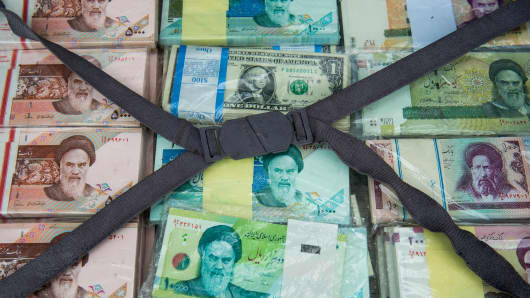 A briefcase filled with Iranian rial banknotes sits on display at a currency exchange market on Ferdowsi street in Tehran, Iran, on Saturday, Jan. 6, 2018.