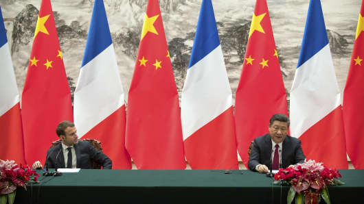 French President Emmanuel Macron and Chinese President Xi Jinping during a joint press briefing at the Great Hall of the People on January 9, 2018 in Beijing, China.