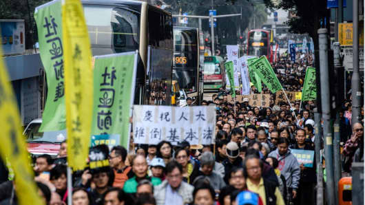 A pro-democracy rally in Hong Kong on January 1, 2018. Angry protesters marched through Hong Kong against what they described as suppression by Beijing, days after Chinese authorities ruled that part of a city rail station would come under mainland law.