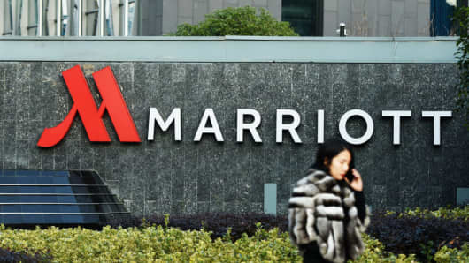 A woman walking past Marriott signage in Hangzhou in China's Zhejiang province. Authorities in China have shut down Marriott's local website for a week after the US hotel giant mistakenly listed Chinese-claimed regions such as Tibet and Hong Kong as separate countries.