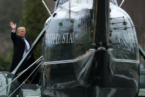 U.S. President Donald Trump waves to members of the media before boarding Marine One following his first medical exam at Walter Reed National Military Medical Center