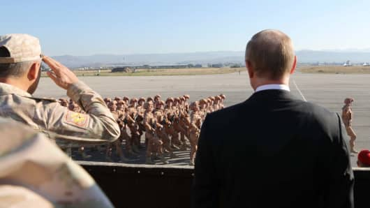 Latakia, Syria December 11, 2017: Russia's Defense Minister Sergei Shoigu (L) and Russia's President Vladimir Putin at the Russian Hmeimim air base. Putin has ordered Russian troops to start pulling out of Syria.