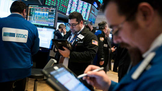 Traders and financial professional work ahead of the closing bell on the floor of the New York Stock Exchange, Jan. 12, 2018 in New York City.
