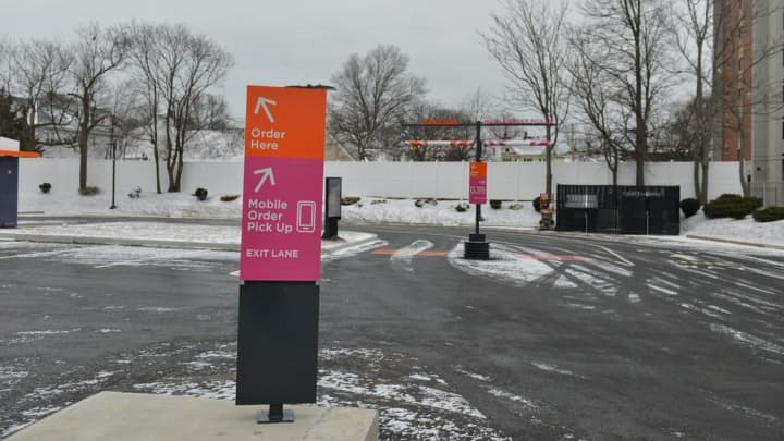 An exclusive On-the-Go drive-thru lane lets DD Perks members who order ahead via Dunkin's Mobile merge straight into the line for the pickup window.