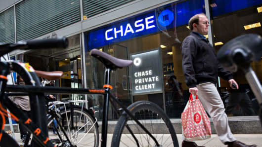 Pedestrians walk outside a JPMorgan Chase & Co. Chase bank in Chicago.