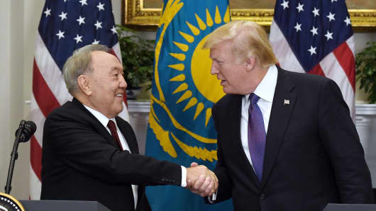 U.S. President Donald Trump shakes hands with President Nursultan Nazarbayev of Kazakhstan.
