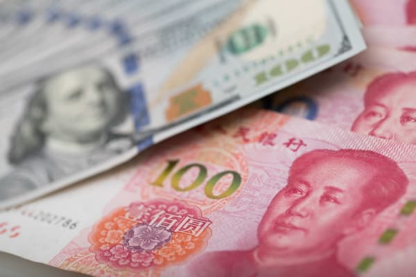 US dollar and China Yuan arranged for a photograph on September 7, 2017.