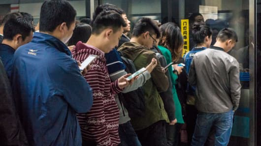 Passengers using their mobile phones on the Chengdu Subway in 2017.