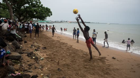 Youngsters play football in Sao Tome city on January 1, 2018.