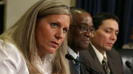 Department of Veterans Affairs employee, Kristen Ruell (L), Veterans Benefits Service Representative Ronald Robinson (C), and Former Veterans Benefits Representative Javier Soto (R) speak at the House Hearing on Veterans Benefits in the Cannon House Office Building on July 14, 2014 at Capitol Hill in Washington, DC.