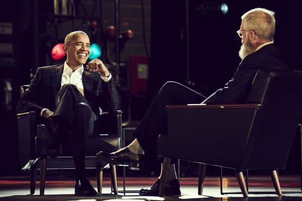 "Former U.S. president Barack Obama sits on stage with David Letterman for interview on ""My Guest Needs No Introduction with David Letterman."""
