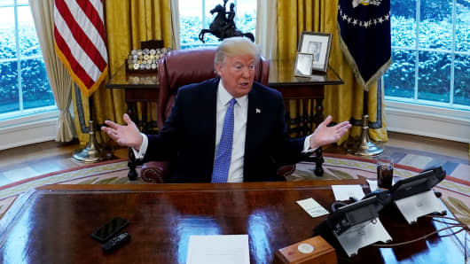 President Donald Trump speaks during an interview with Reuters at the White House in Washington, U.S., January 17, 2018.