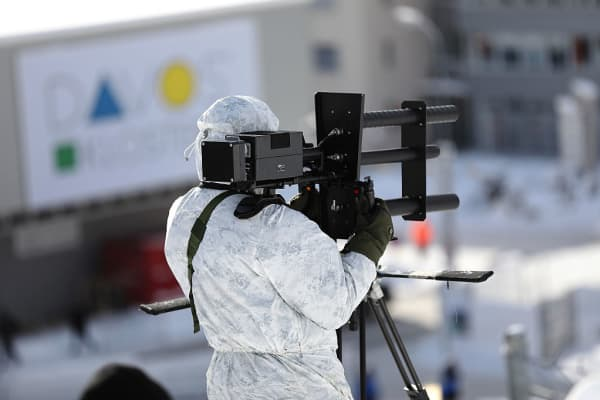 A member of a police unit practices using an anti-drone gun as part of the security exercises ahead of the World Economic Forum (WEF) in Davos, Switzerland, on Monday, Jan. 16, 2017.