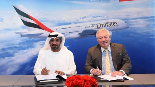 HH Sheikh Ahmed bin Saeed Al Maktoum, Chairman and Chief Executive, Emirates Airline and Group (L), and John Leahy, Chief Operating Officer Customers, Airbus Commercial Aircraft.