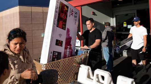 Shoppers leave Best Buy after purchasing merchandise in Los Angeles.