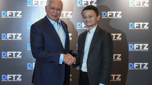 Malaysia's Prime Minister Najib Razak and Alibaba Group founder and executive chairman Jack Ma after the launching of the country's Digital-Free Trade Zone in Kuala Lumpur on March 22, 2017