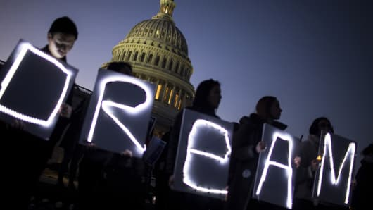 Demonstrators hold illuminated signs during a rally supporting the Deferred Action for Childhood Arrivals program (DACA), or the Dream Act, outside the U.S. Capitol building in Washington, D.C., Jan. 18, 2018.