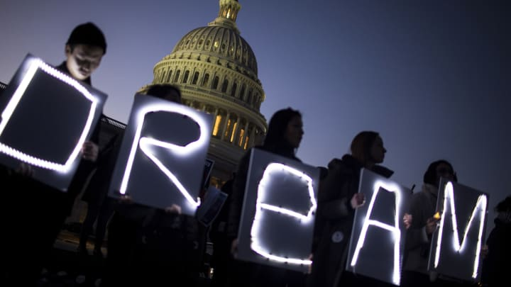 Demonstrators hold illuminated signs during a rally supporting the Deferred Action for Childhood Arrivals program (DACA), or the Dream Act, outside the U.S. Capitol building in Washington, D.C., on Thursday, Jan. 18, 2018.