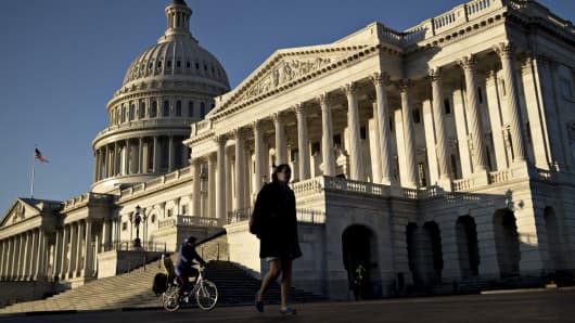 A pedestrian walks past the U.S. Capitol in Washington, D.C.