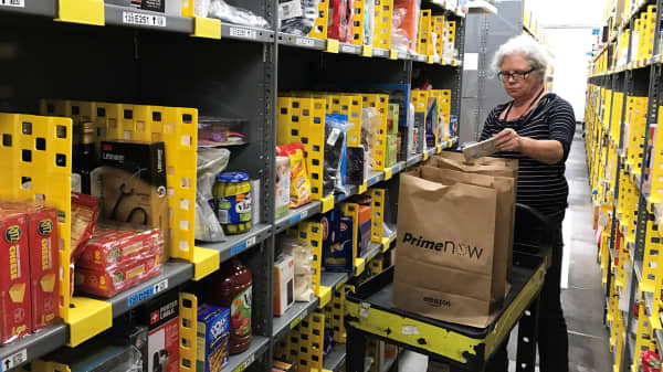 An employee collects items ordered by Amazon.com customers through the company's two-hour delivery service Prime Now in a warehouse in San Francisco.