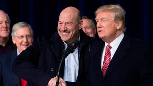 President Donald Trump shakes hands with Gary Cohn, Director of the National Economic Council, during a retreat with Republican lawmakers and members of his Cabinet at Camp David in Thurmont, Maryland, January 6, 2018.