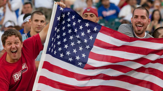USA fans celebrate by waving the US flag during game play. The United States defeated Panama