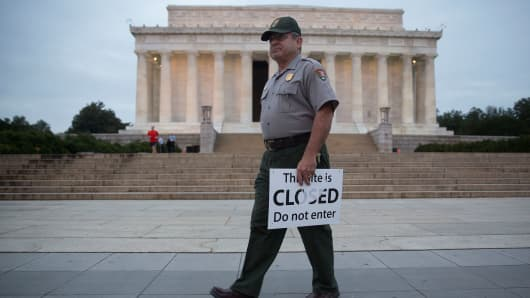 A National Park Service park ranger holds a closed sign near the Lincoln Memorial in Washington, D.C.