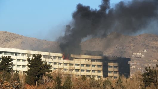 Smoke billows from the Intercontinental Hotel after an attack by armed gunmen in Kabul, Afghanistan, 21 January 2018.