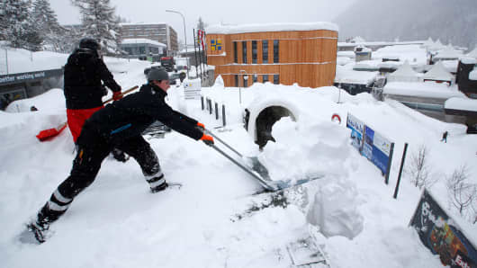 Staff removes snow ahead of the World Economic Forum (WEF) annual meeting in the Swiss Alps resort of Davos, Switzerland January 21, 2018.