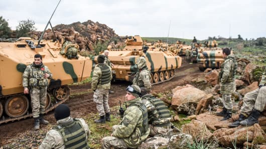 Turkish army troops gather near the Syrian border at Hassa, in Hatay province on January 21, 2018.