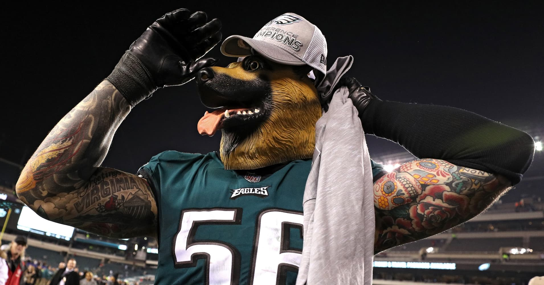 Chris Long of the Philadelphia Eagles celebrates his teams win while wearing a dog mask over the Minnesota Vikings in the NFC Championship.
