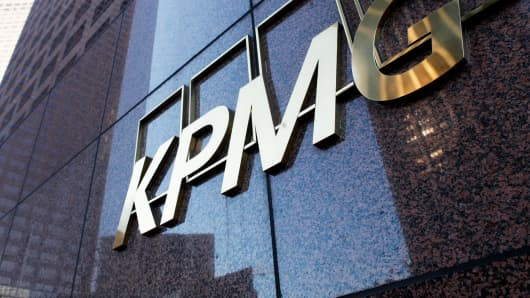 Ex-KPMG partners charged with stealing exam to get passing grade by audit inspector