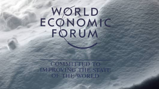 A World Economic Forum (WEF) sign stands inside the Congress Center as a drift of heavy snow sits behind ahead of the World Economic Forum (WEF) in Davos, Switzerland, on Monday, Jan. 22, 2018.