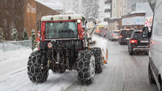 A snow plow clears the road in Davos, Switzerland on Jan. 23rd, 2018/