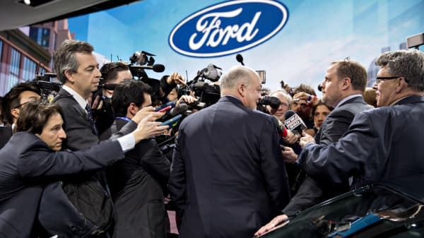 Jim Hackett, president and chief executive officer of Ford Motor Co., center, speaks to members of the media at an event during the 2018 North American International Auto Show (NAIAS) in Detroit, Jan. 14, 2018.