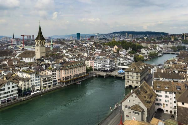 This panorama was taken from the top of the Zurich's Grossmunster Cathedral. This aerial view shows Zurich's old town bordering the Limmat River.