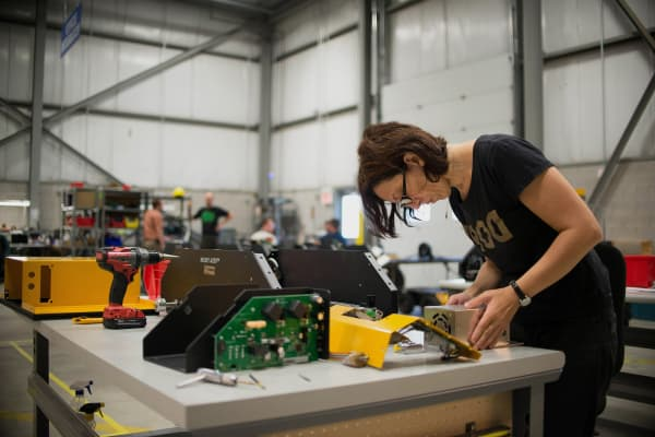 An engineer hand assembles the Husky robot at the Clearpath Robotics Inc. facility in Kitchener, Ontario, Canada.