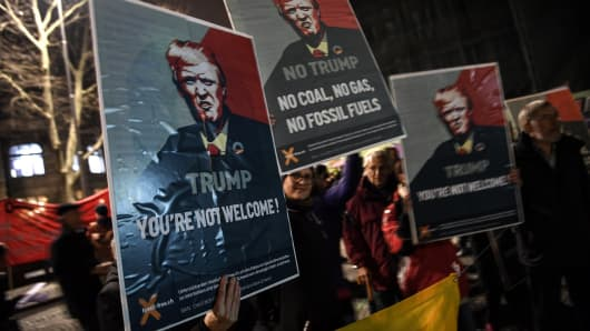 People rally as they protest against the attendance of the US president to the upcoming Davos World Economic Forum, on January 23, 2018, in central Zurich.