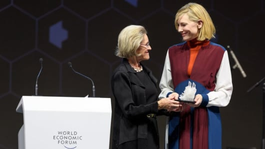 Australian actress Cate Blanchett (R) receives a Crystal Award from the hands of Schwab Foundation for Social Entrepreneurship Chairperson and Co-Founder Hilde Schwab during a ceremony ahead of the World Economic Forum (WEF) 2018 annual meeting, on January 22, 2018 in Davos, eastern Switzerland