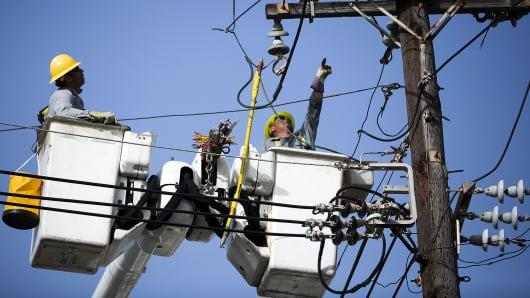 Puerto Rico Electric Power Authority (PREPA) employees fix power lines in Santurce, San Juan, Puerto Rico