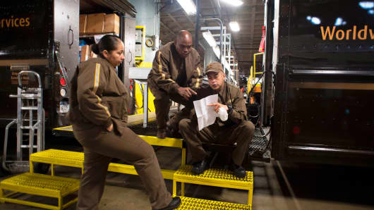 UPS drivers wait as their trucks are loaded at a Manhattan UPS facility in New York.