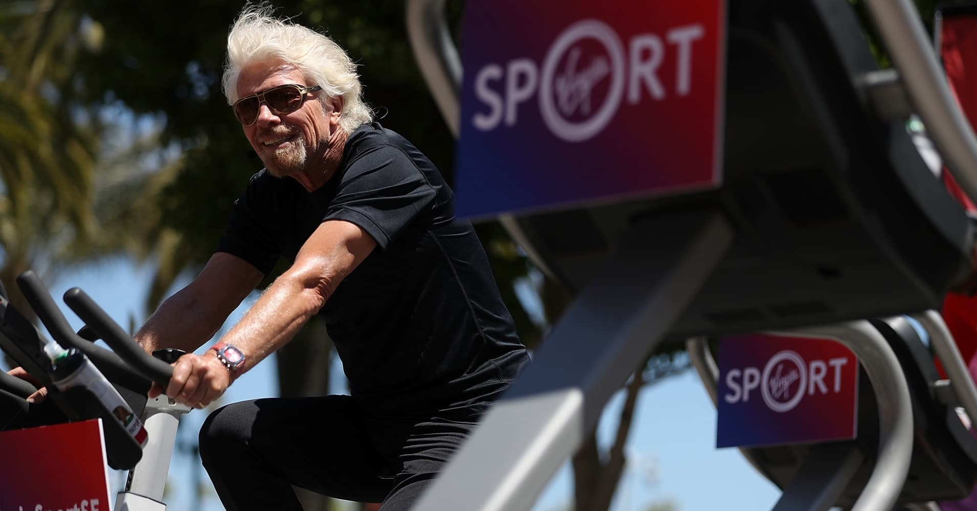 Sir Richard Branson rides an exercise bike during a news conference to announce the launch of Virgin Sport on May 18, 2017 in San Francisco, California.