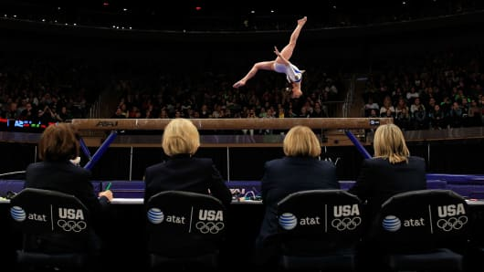 A gymnist competes in the balance beam event at the 2012 AT&T American Cup at Madison Square Garden in New York City.