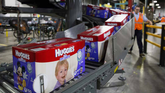 Boxes of Huggies brand diapers move along a conveyor belt at the Kimberly-Clark manufacturing facility in Paris, Texas.