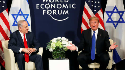U.S. President Donald Trump speaks with Israeli Prime Minister Benjamin Netanyahu during the World Economic Forum (WEF) annual meeting in Davos, Switzerland January 25, 2018.