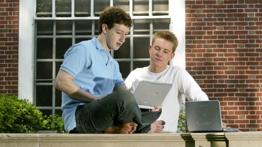 Mark Zuckerberg (L) and Chris Hughes (R) of 'Facebook' photographed at Eliot House at Harvard University, Cambridge, MA. on May 14, 2004.