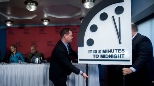 Members of the Bulletin of the Atomic Scientists take their seats after moving their Doomsday clock 30 seconds closer to the end of the world January 25, 2018 in Washington, DC.